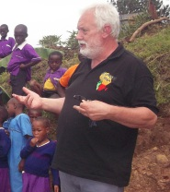 Lawrance discussing development of a community school in Uganda